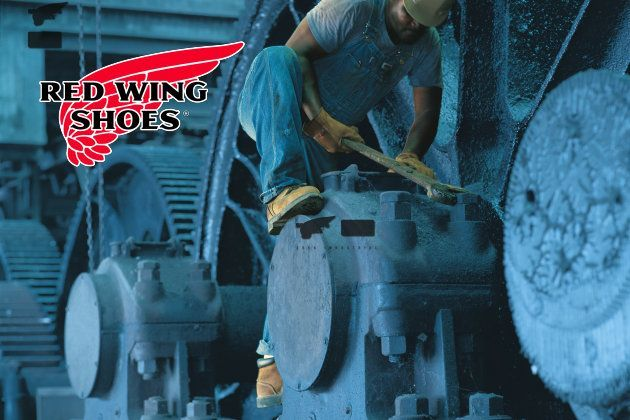 Red Wing man working on large machinery